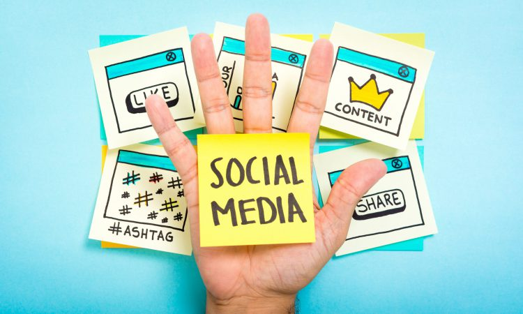 Social,Media,On,Hand,With,Blue,Background.,Content,Marketing.